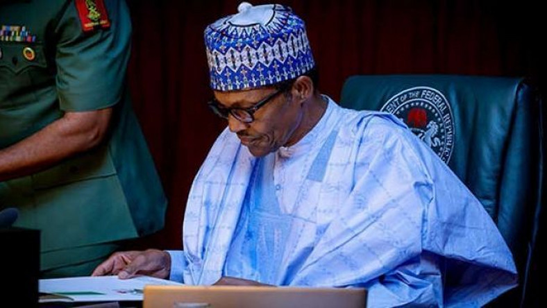 Buhari signs June 12 bill into law